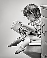 Bathroom baby girl reading