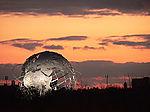 P3 globe sunset