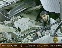 Gaza man in rubble