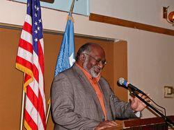 Coe at podium
