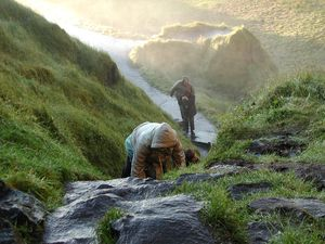 Iceland climbing waterfall