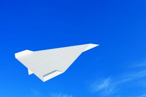 Jet blue paper airplane