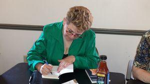 Signing books me