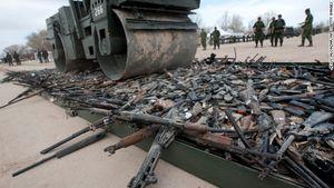 Guns being crushed