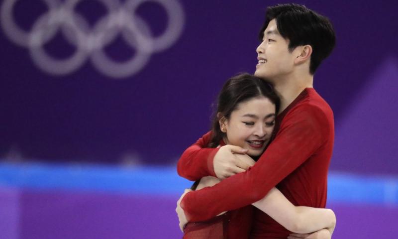 Shibutani hugging
