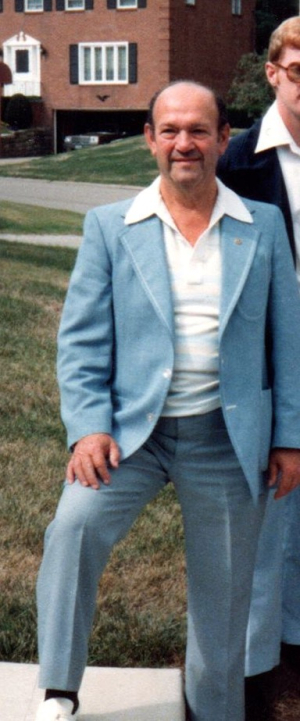 Saul cropped in blue suit 1982